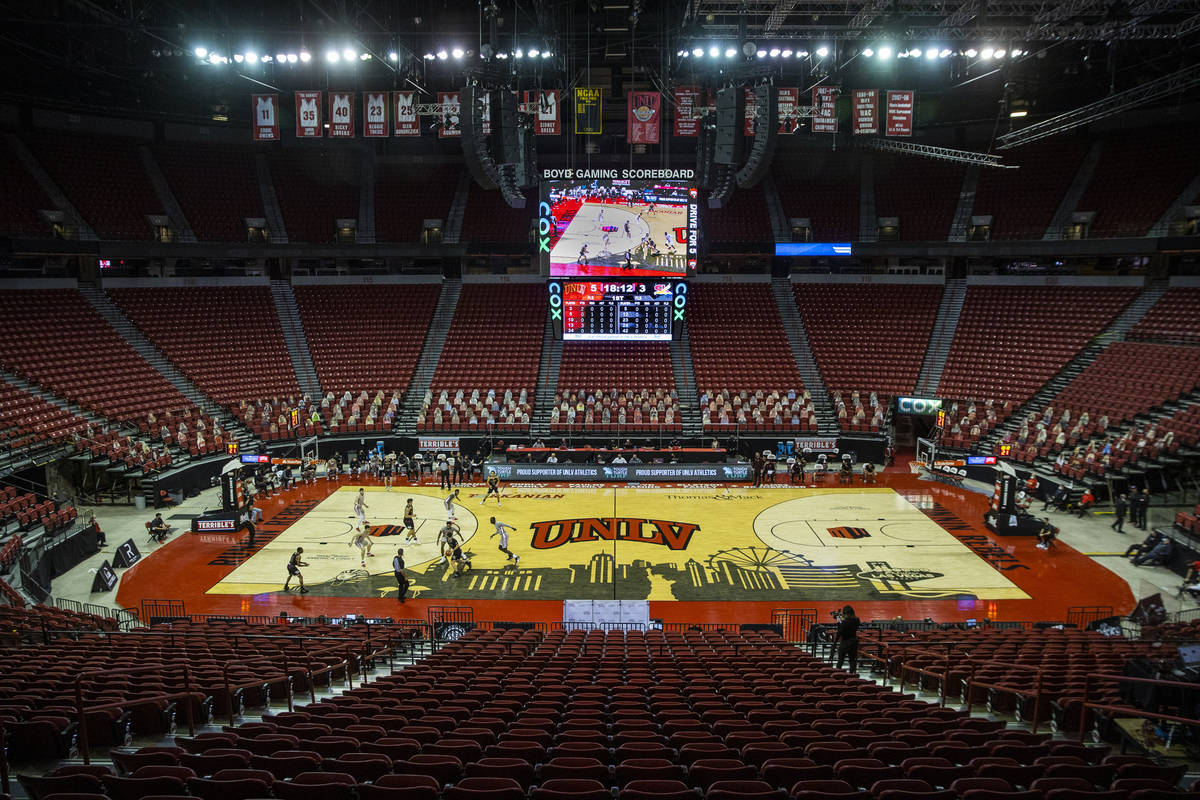The UNLV Rebels and Saint Katherine battle before cardboard cutouts during the first half of an ...