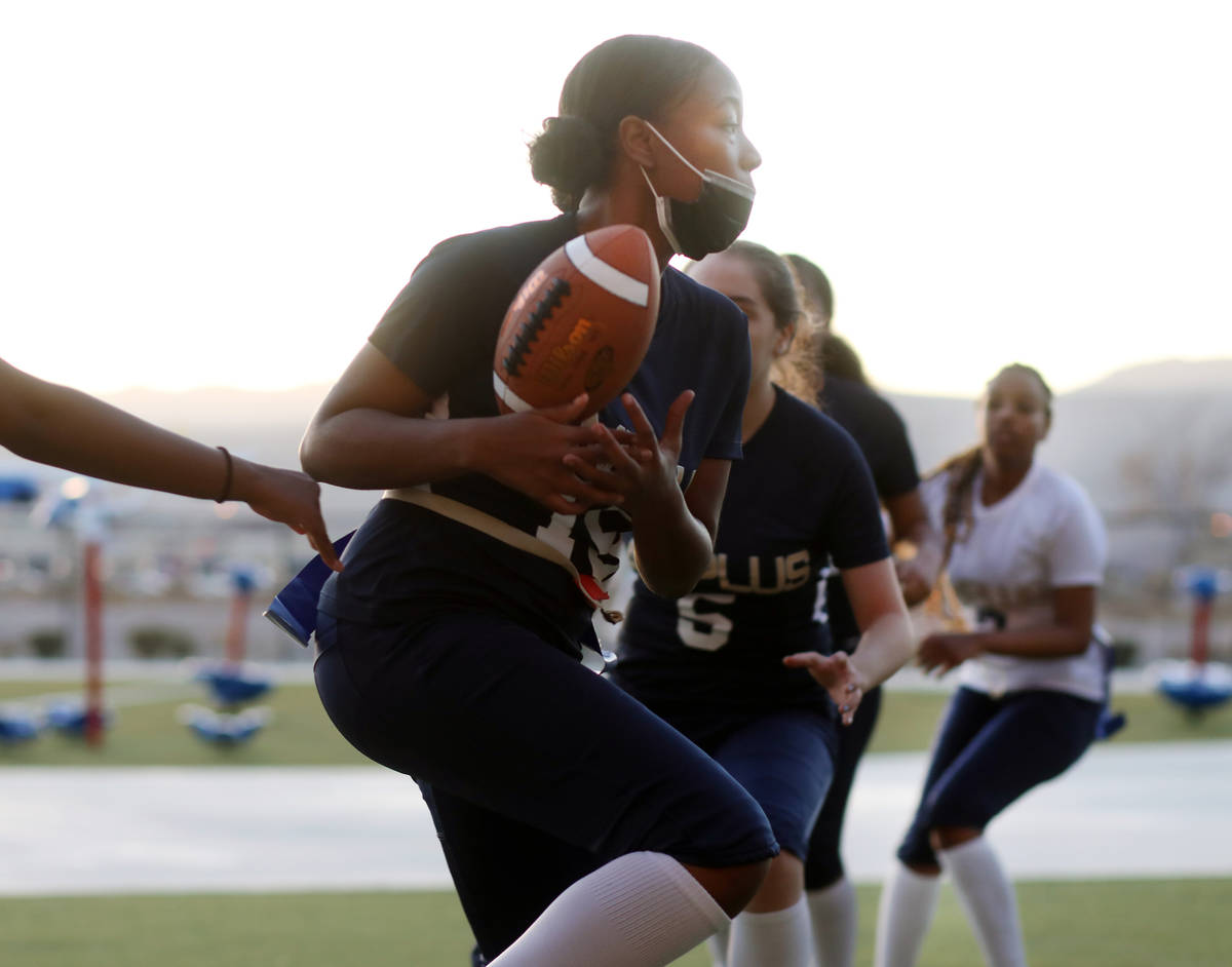 Tiani Moore, 15, wide receiver, catches the ball during flag football practice at Amplus High S ...