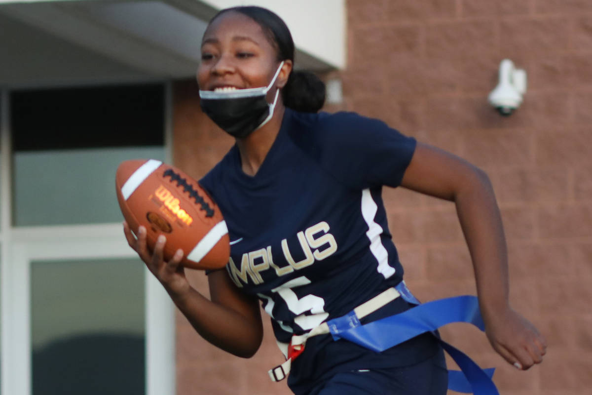 Tiani Moore, 15, wide receiver, runs the ball during flag football practice at Amplus High Scho ...