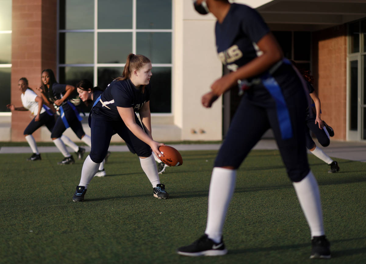 Amplus High School flag football center Rilee Rambow (55) hikes the ball during practice at Amp ...
