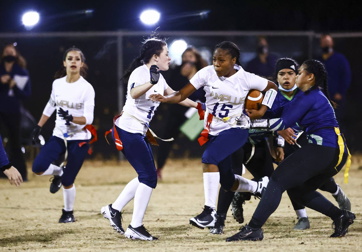 Amplus Academy Tiani Moore (15) tries to break through SLAM! Nevada defense during a flag footb ...