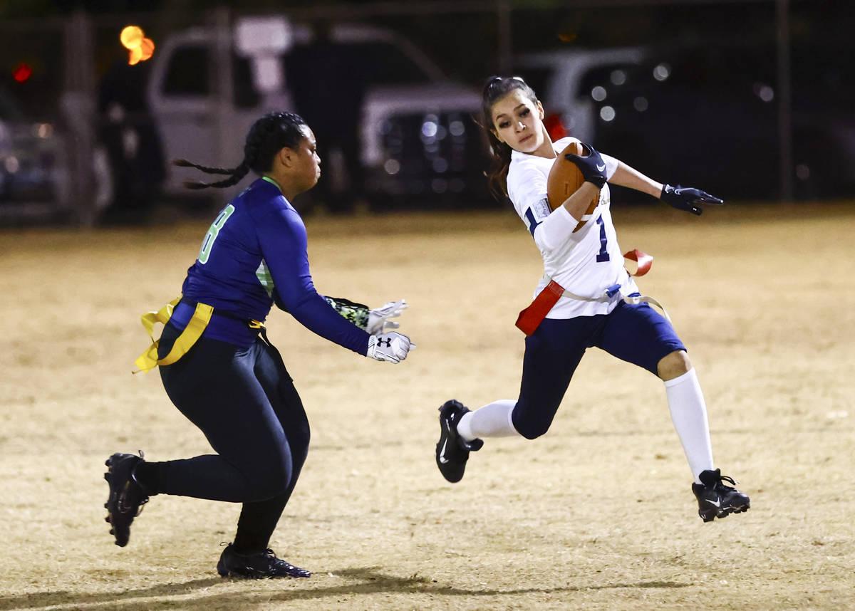 Amplus Academy's Karina Hudzenko (1) runs the ball past SLAM! Nevada's Sasha Ia during a flag f ...
