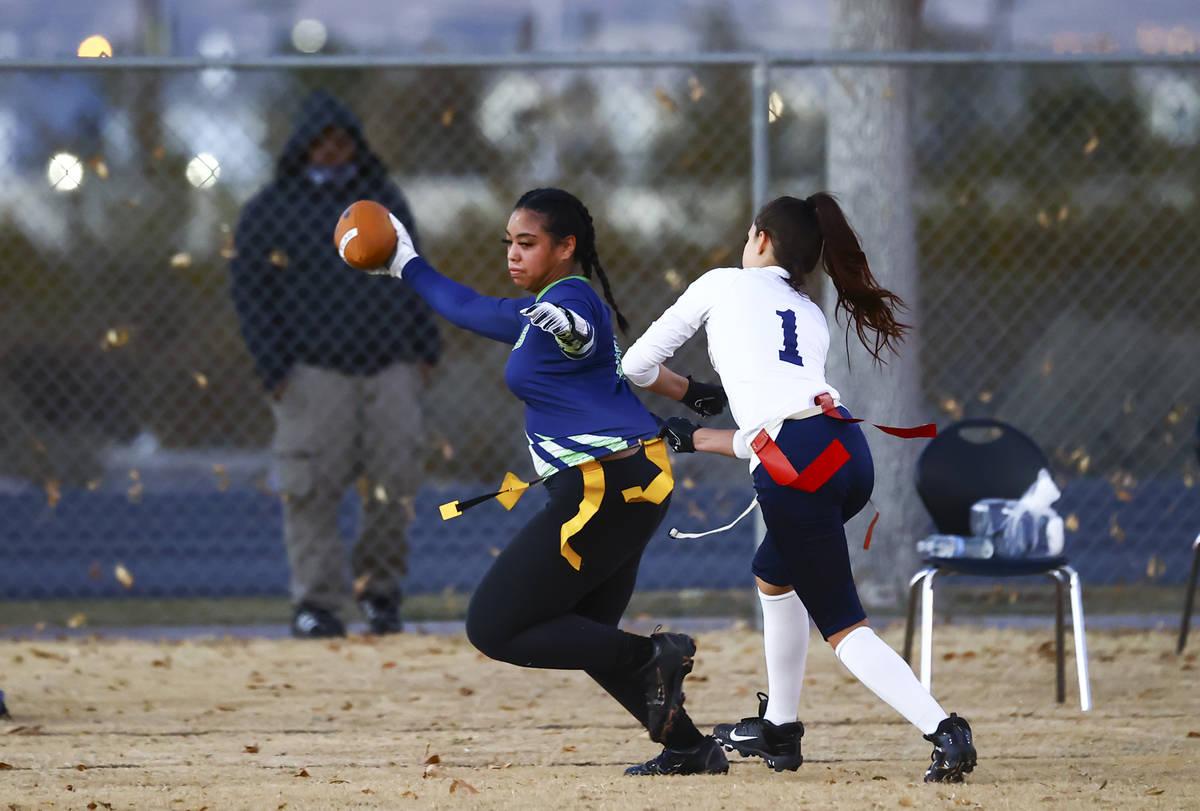 SLAM! Nevada's Sasha Ia (18) gets tagged out by Amplus Academy's Karina Hudzenko (1) during a f ...