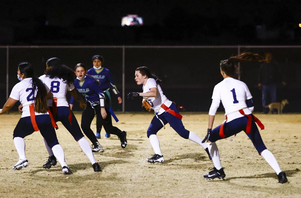 Amplus Academy Kaitlyn Pruitt (13) runs the ball after intercepting a pass from SLAM! Nevada du ...