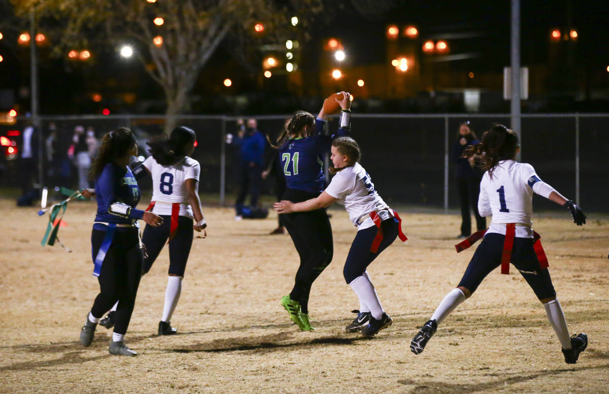 SLAM! Nevada's Sydney Cox (21) scores a touchdown against Amplus Academy during a flag football ...