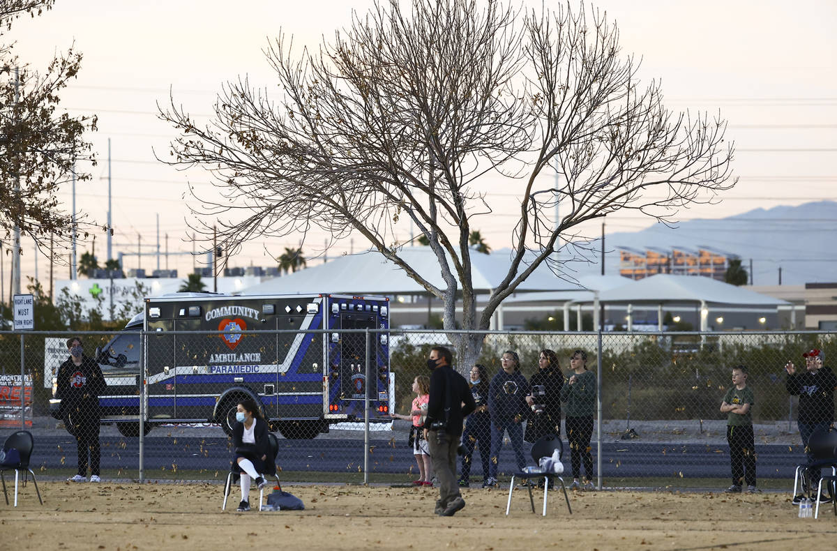 People watch the action from the sidewalk as Amplus Academy takes on SLAM! Nevada during a flag ...
