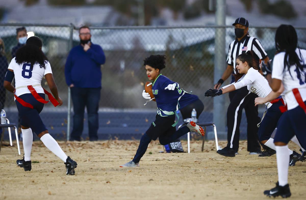 SLAM! Nevada's Iris Cardoza runs the ball against Amplus Academy during a flag football game at ...
