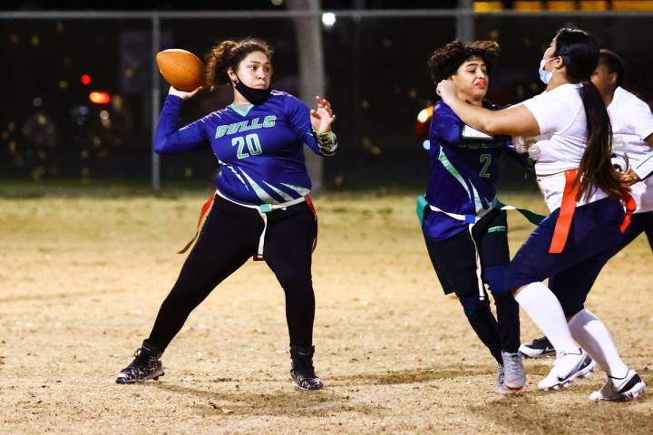 SLAM! Nevada's Lizette Valenciano looks to throw a pass during a flag football game against Amp ...