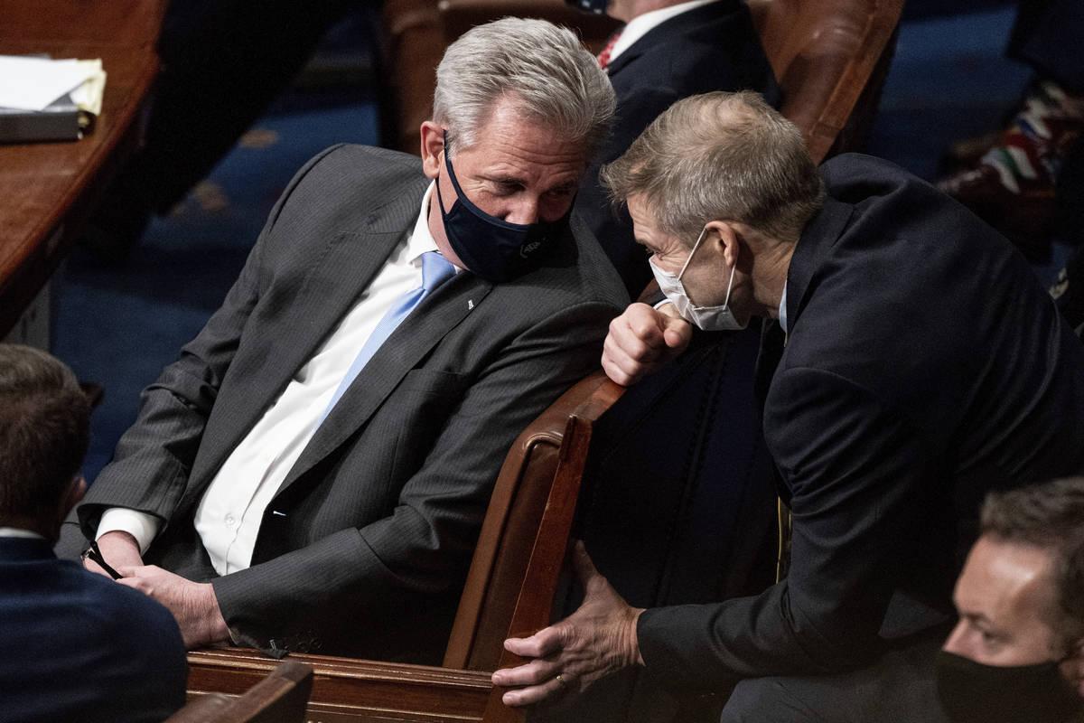 House Minority Leader Kevin McCarthy, R-Calif., and Rep. Jim Jordan, R-Ohio, talk as a joint se ...