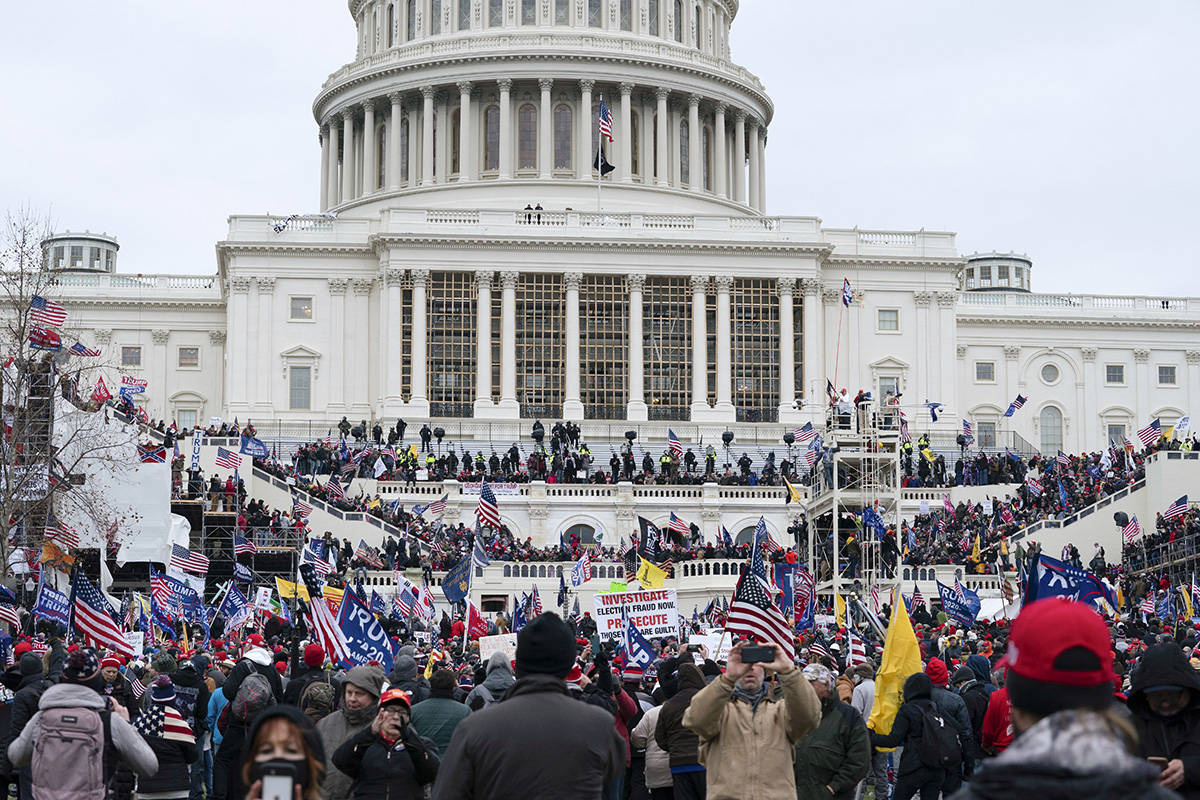 Trump supporters gather outside the Capitol, Wednesday, Jan. 6, 2021, in Washington. As Congres ...