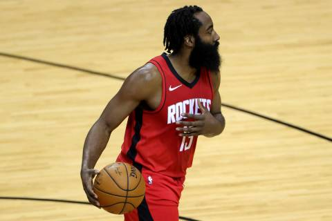 Houston Rockets' James Harden controls the ball during the first quarter of an NBA basketball g ...