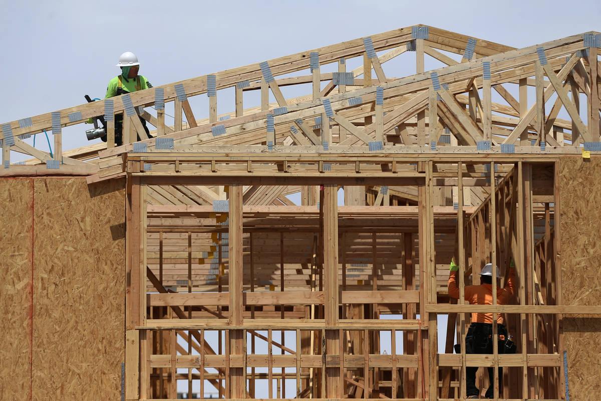 Erik Verduzco Las Vegas Review-Journal In April, construction workers are shown building a home ...