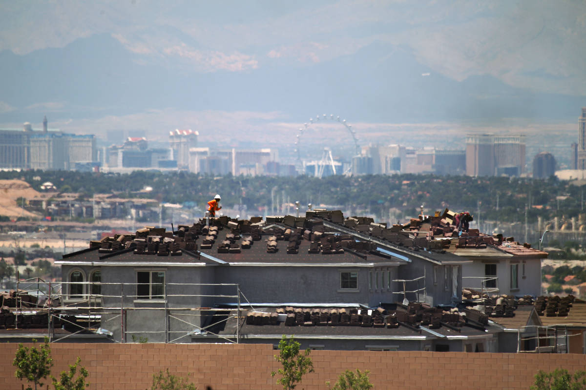 In 2015, workers are on shown on roofs building homes in Cadence, a master-planned community in ...