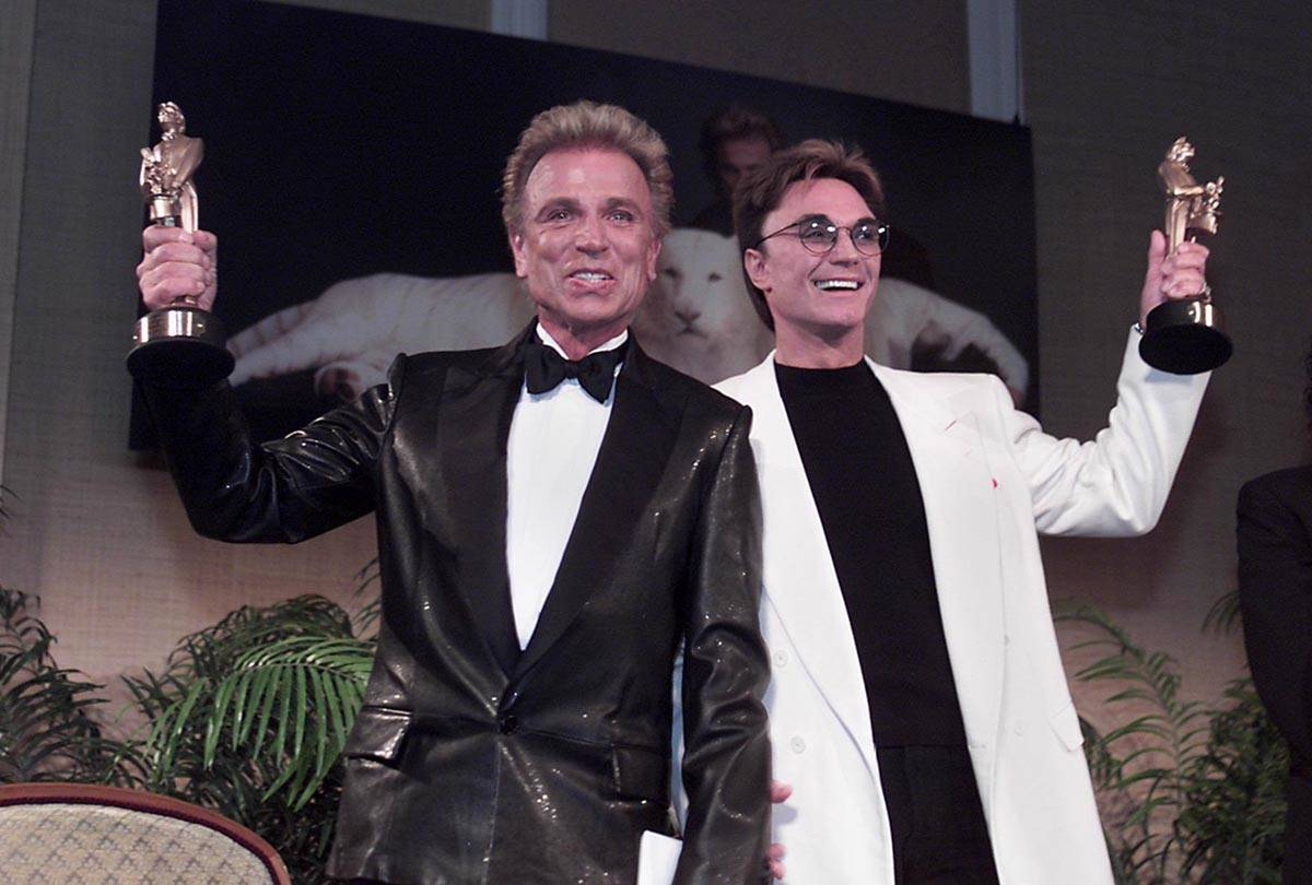 Las Vegas legends Siegfried, left, and Roy show their Merlin statuettes after being named Magic ...
