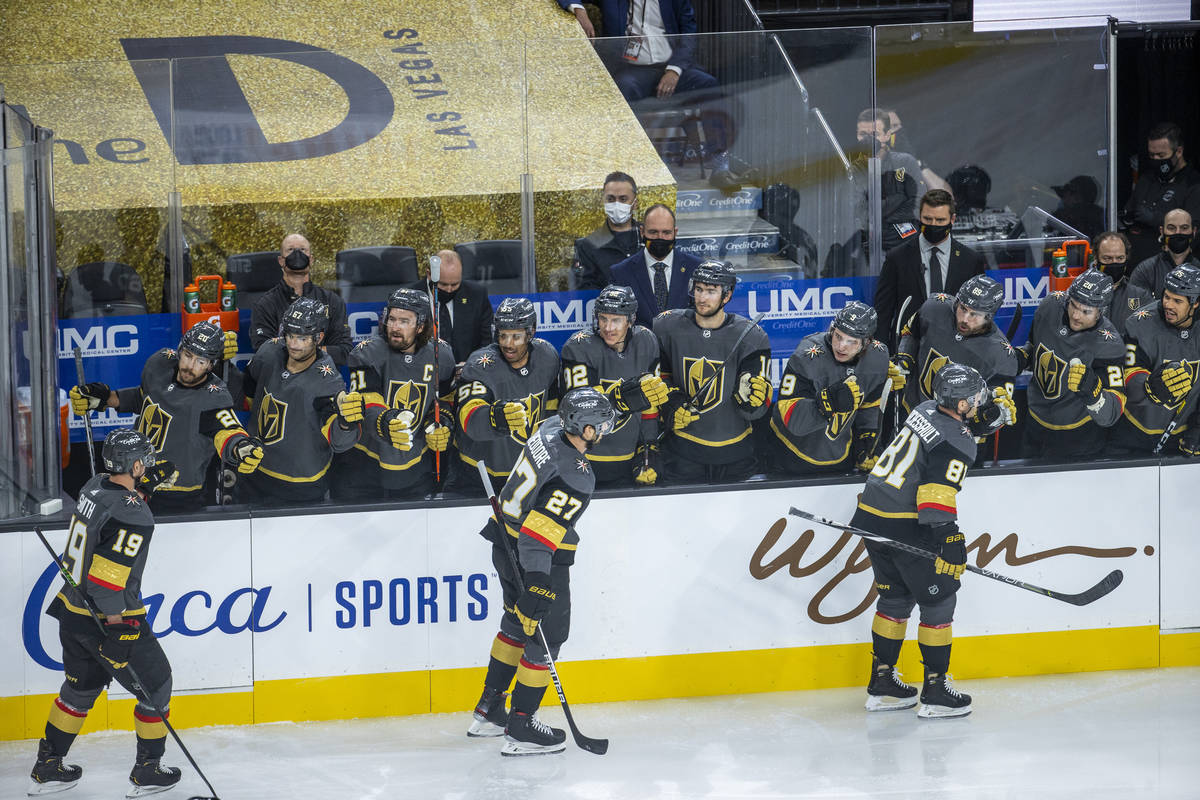 Golden Knights center Jonathan Marchessault (81) celebrates his goal with teammates during the ...