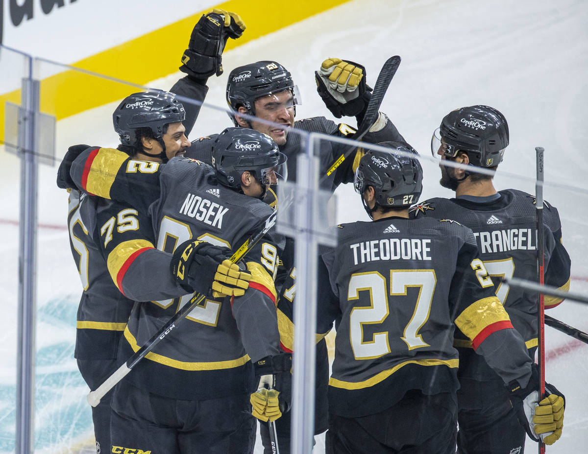 Golden Knights right wing Tomas Nosek (92) celebrates his goal with teammates versus the Anahei ...