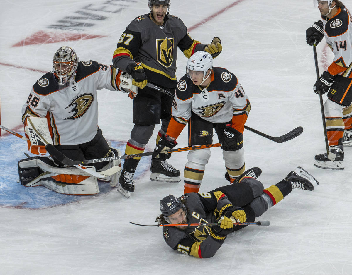Golden Knights right wing Mark Stone (61) hits the ice after colliding with Anaheim Ducks defen ...
