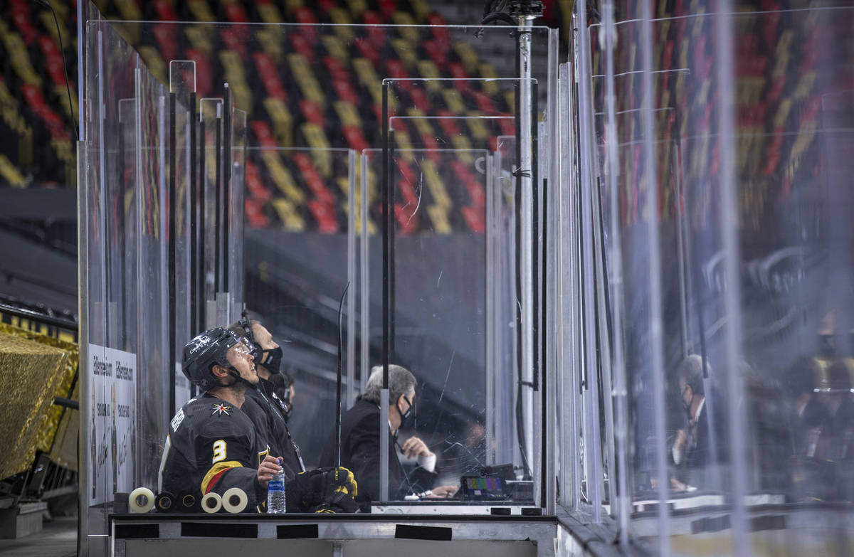 Golden Knights defenseman Brayden McNabb (3) looks to the display from the penalty box versus t ...