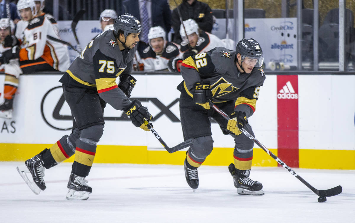 Golden Knights right wing Tomas Jurco (92) drives to the net with teammate Golden Knights right ...