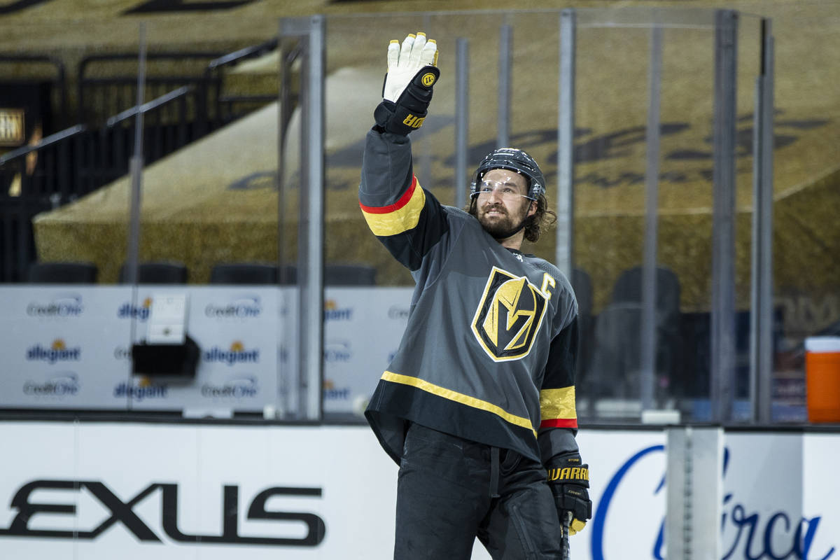 Golden Knights right wing Mark Stone (61) waves thanks to the empty seats after their 5-2 win o ...