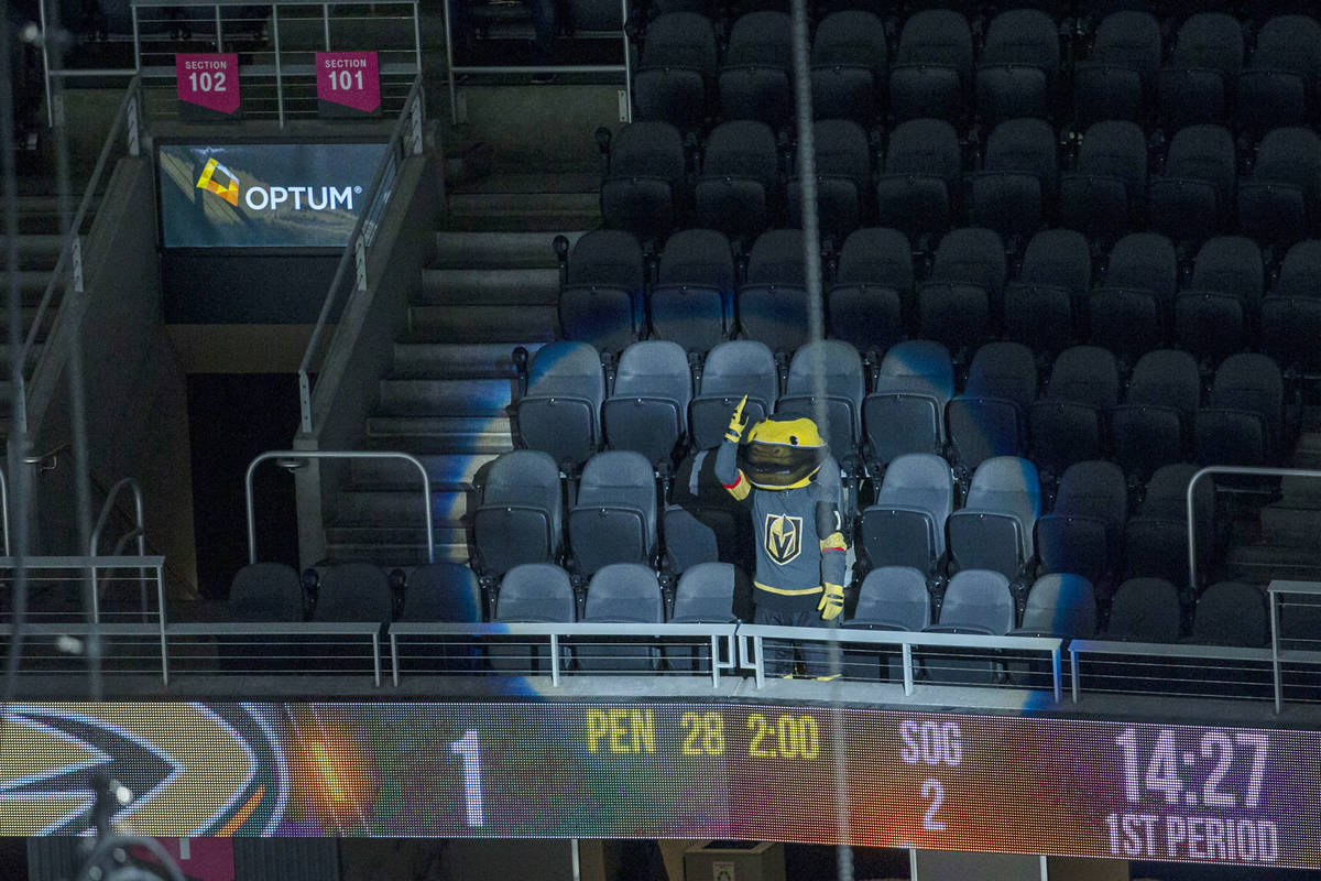 Vegas Golden Knights mascot Chance cheers on the team in an empty arena during the first period ...