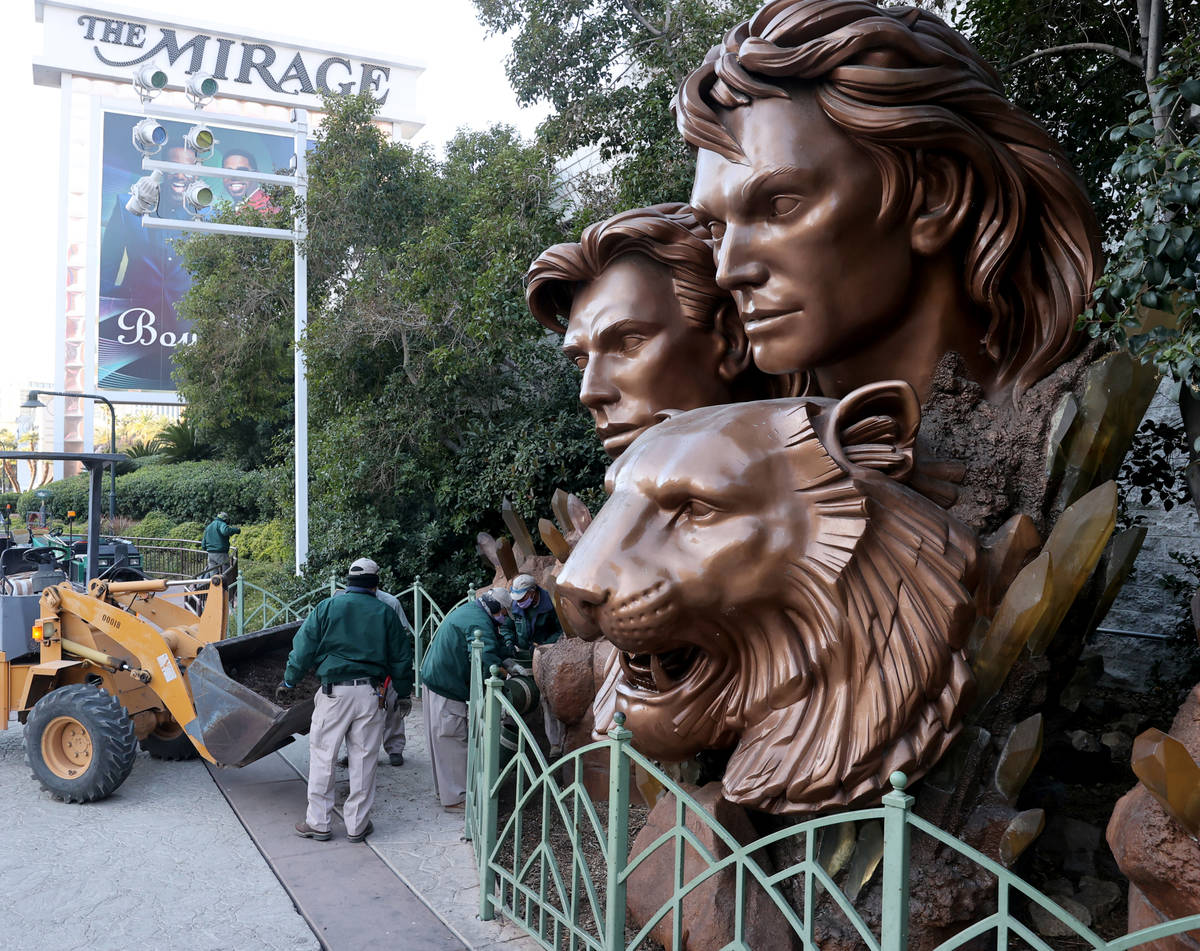 Maintenance employees work on the area around a statue of Siegfried & Roy on the Strip in f ...