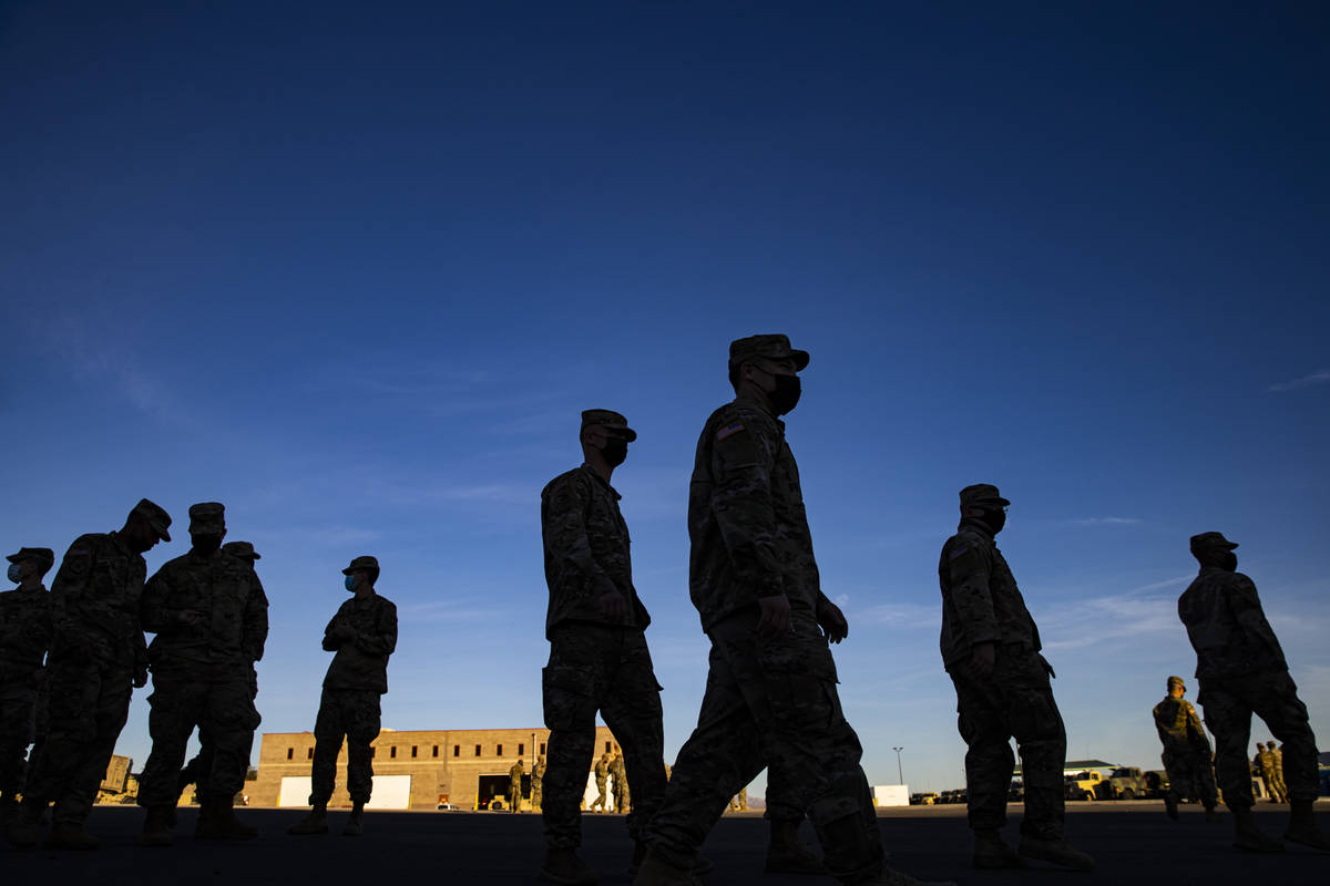 Members of the Nevada Army Guard prepare on Thursday, Jan. 14, 2021, to deploy to Washington, D ...