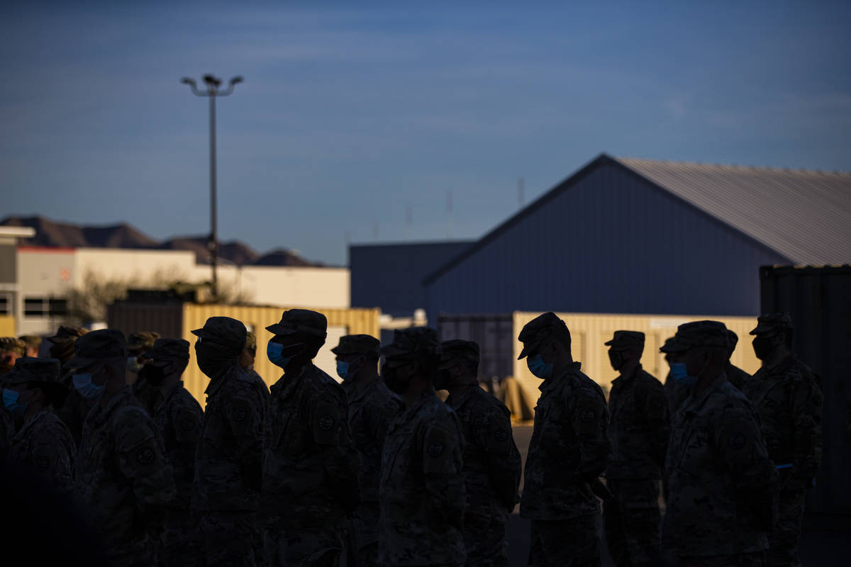 Members of the Nevada Army Guard listen to Maj. Gen. Ondra Berry, not pictured, on Thursday, Ja ...