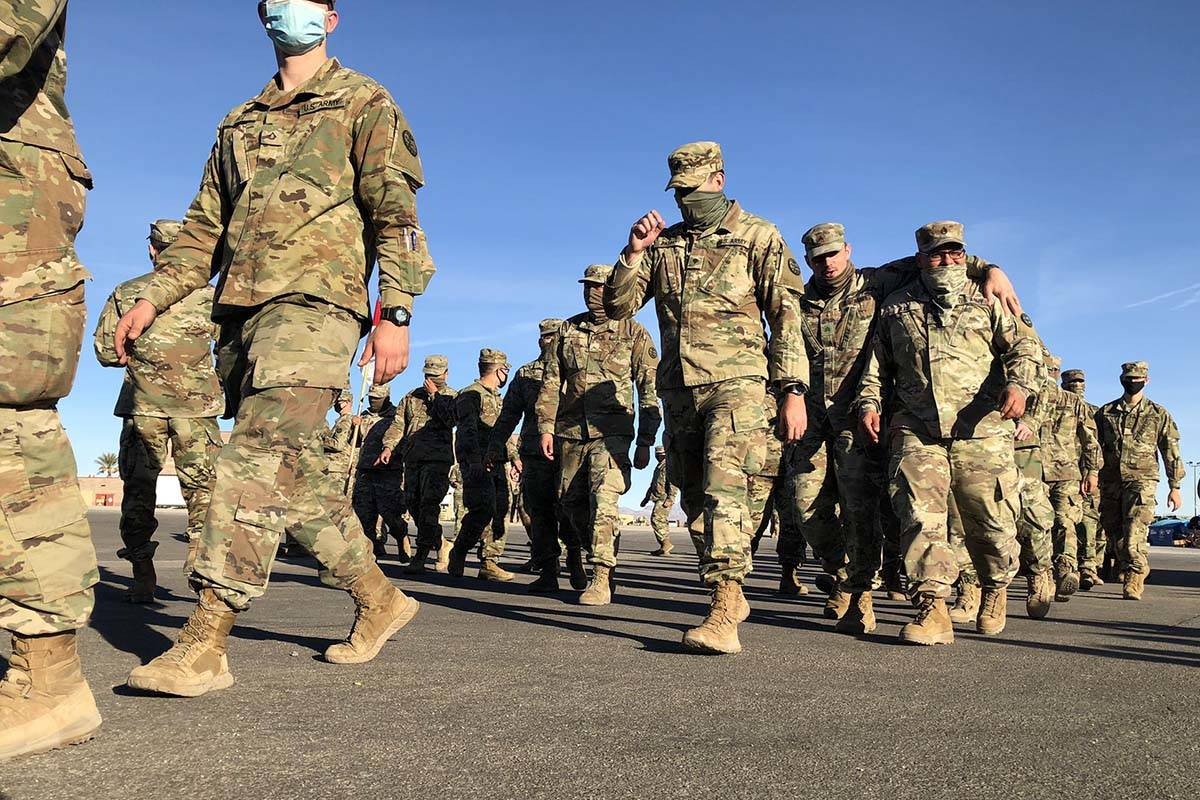 Members of the Nevada Army Guard prepare on Thursday, Jan. 14, 2021, to head to Washington, D.C ...