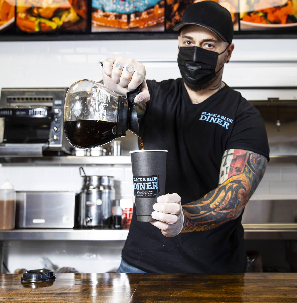 Chef Vic Vegas pours a cup of coffee at his new Black & Blue Diner, which opens Monday at 315 S ...