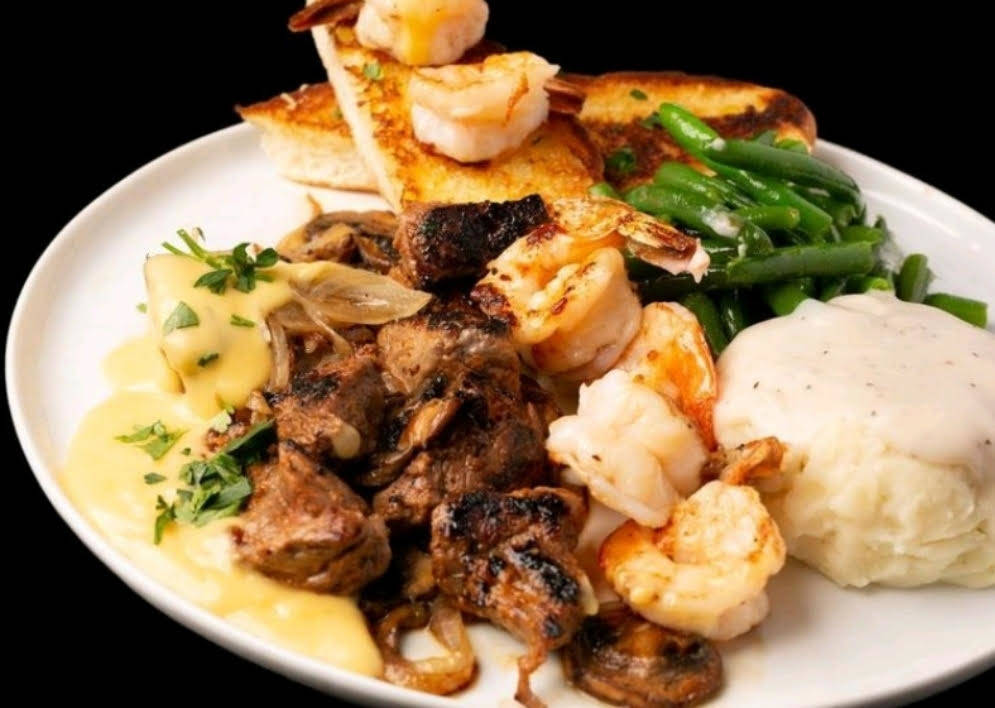 Vegas Surf and Turf includes marinated sirloin tips with grilled onions and mushrooms and grill ...