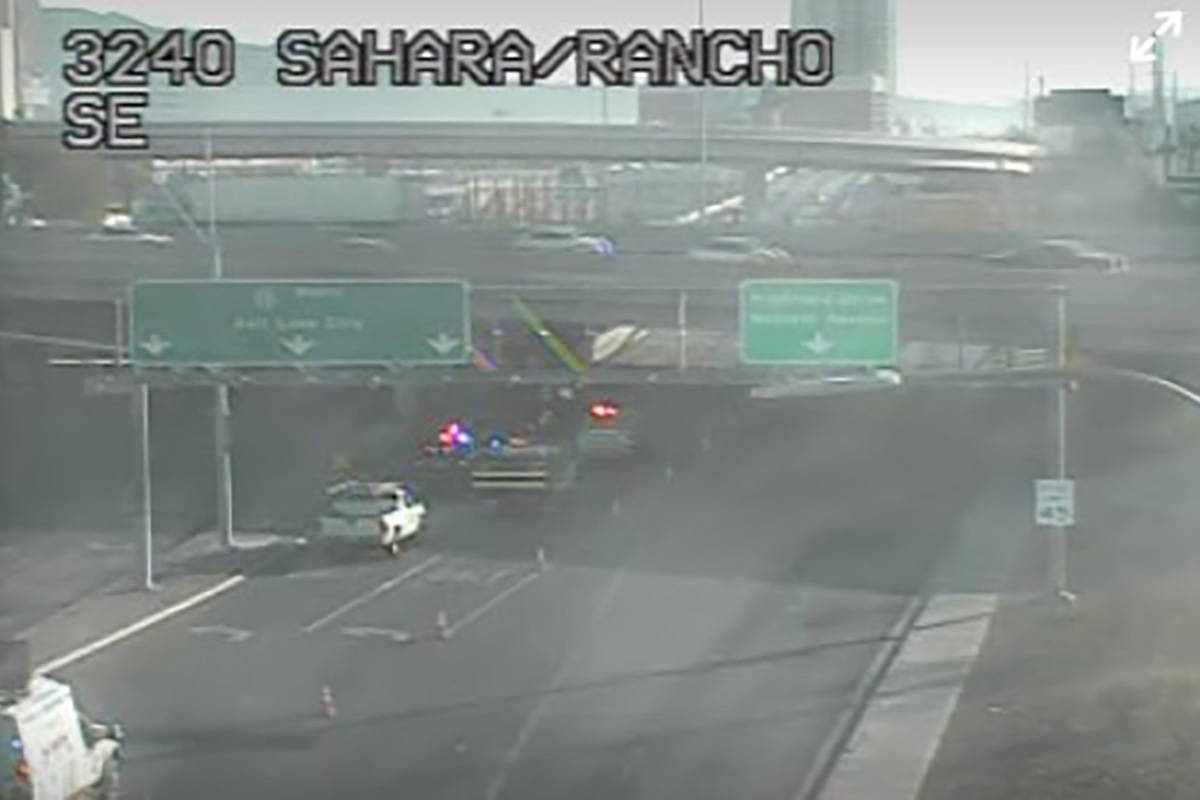A semi-truck overturned in central Las Vegas near Interstate 15 Friday morning, causing traffic ...