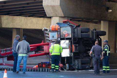 A semi-truck overturned in the eastbound lanes of Sahara Avenue at the I-15 overpass causing tr ...