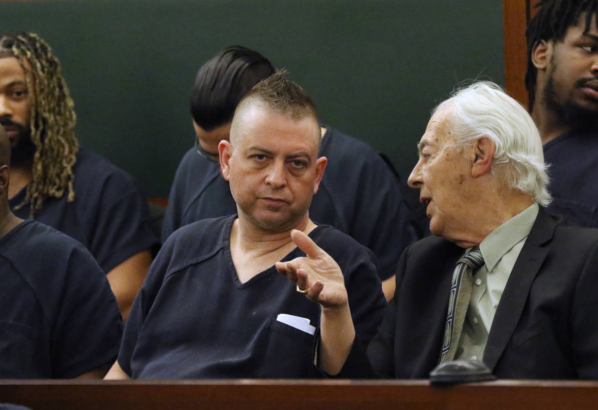 In this March 12, 2020 photo, Bill Terry, right talks to Christopher Prestipino, who was accuse ...
