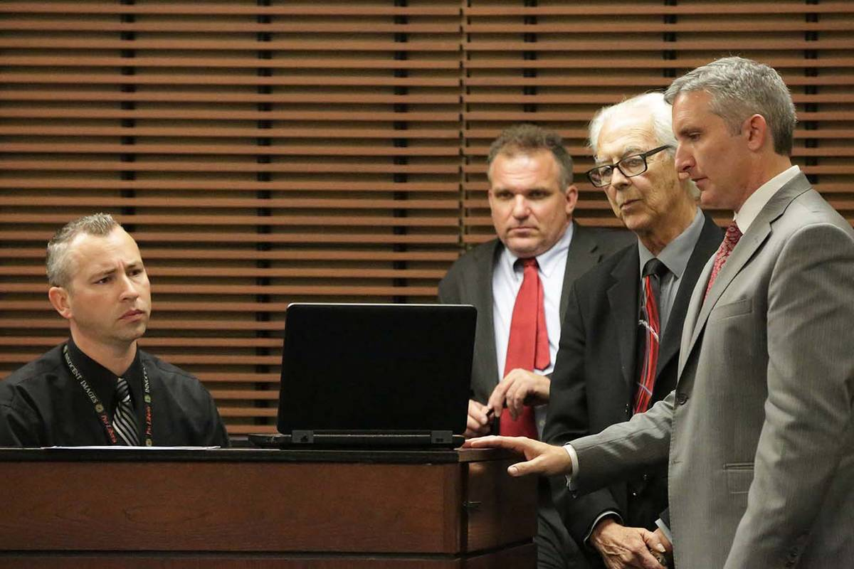 Henderson Police Detective Wayne Nichols, seated, and defense attorneys Keith Brower and Bill T ...