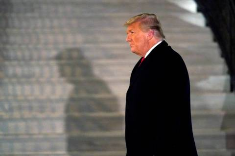 In a Tuesday, Jan. 12, 2021, file photo, President Donald Trump arrives on the South Lawn of th ...