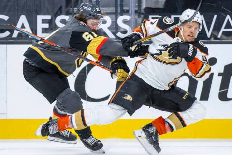 Golden Knights right wing Mark Stone (61) checks Anaheim Ducks defenseman Hampus Lindholm (47) ...