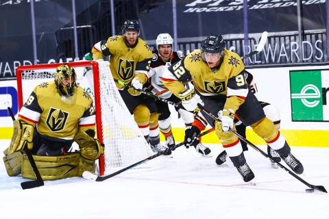 Golden Knights left wing Tomas Nosek (92) skates with the puck during the first period of an NH ...