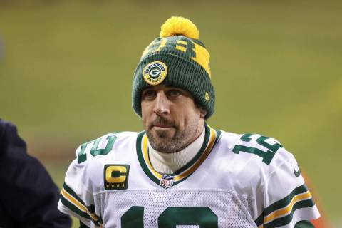 Green Bay Packers quarterback Aaron Rodgers (12) walks off the field after an NFL football game ...