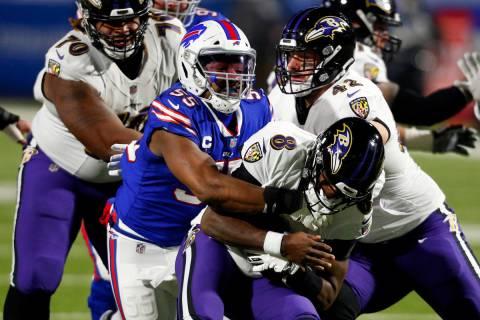 Buffalo Bills' Jerry Hughes (55) sacks Baltimore Ravens quarterback Lamar Jackson (8) during th ...
