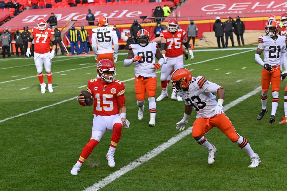 Kansas City Chiefs quarterback Patrick Mahomes (15) scores on a touchdown run during the first ...