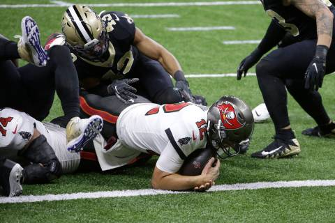 Tampa Bay Buccaneers quarterback Tom Brady (12) scores a touchdown against the New Orleans Sain ...