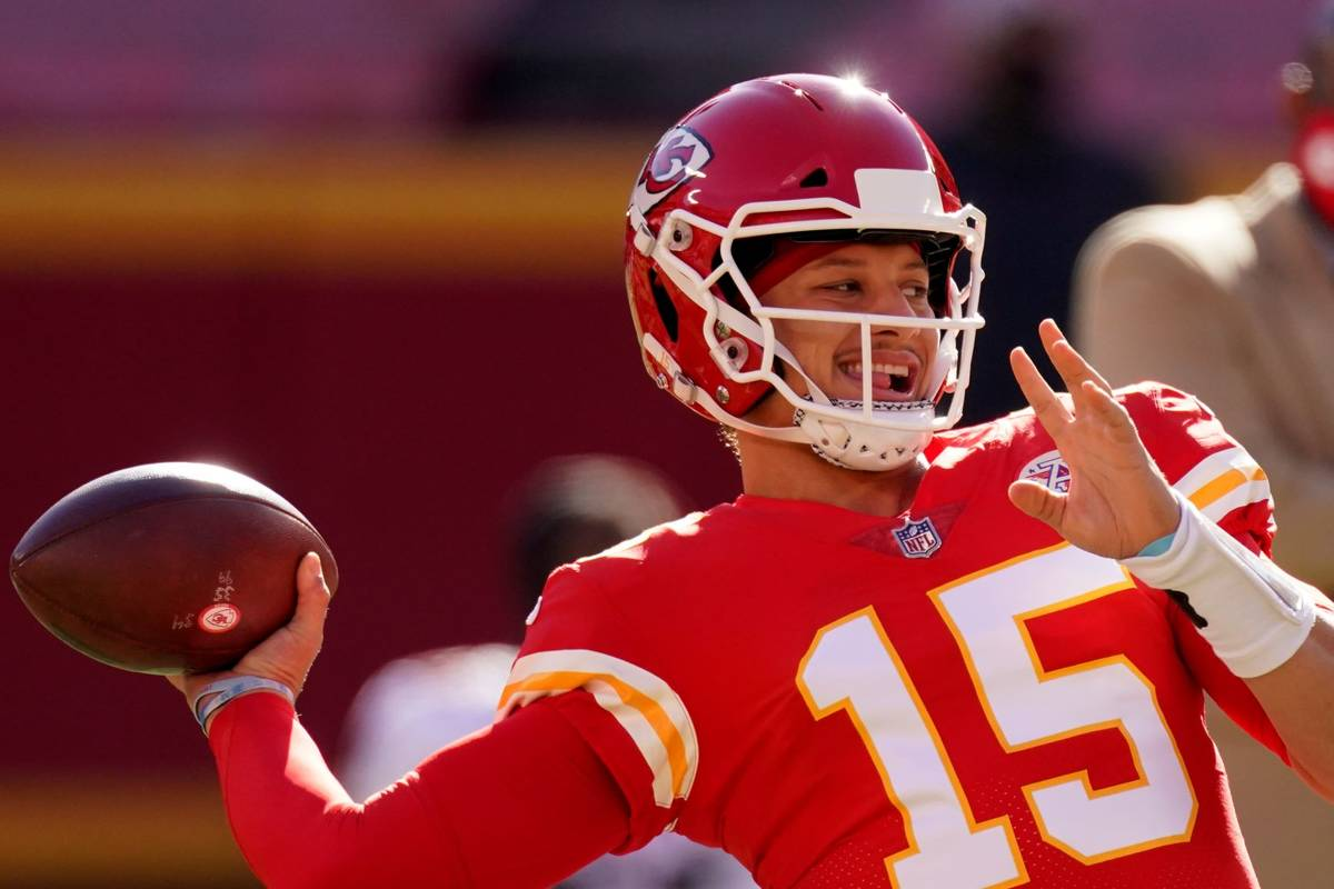 Kansas City Chiefs quarterback Patrick Mahomes throws before an NFL football game against the A ...