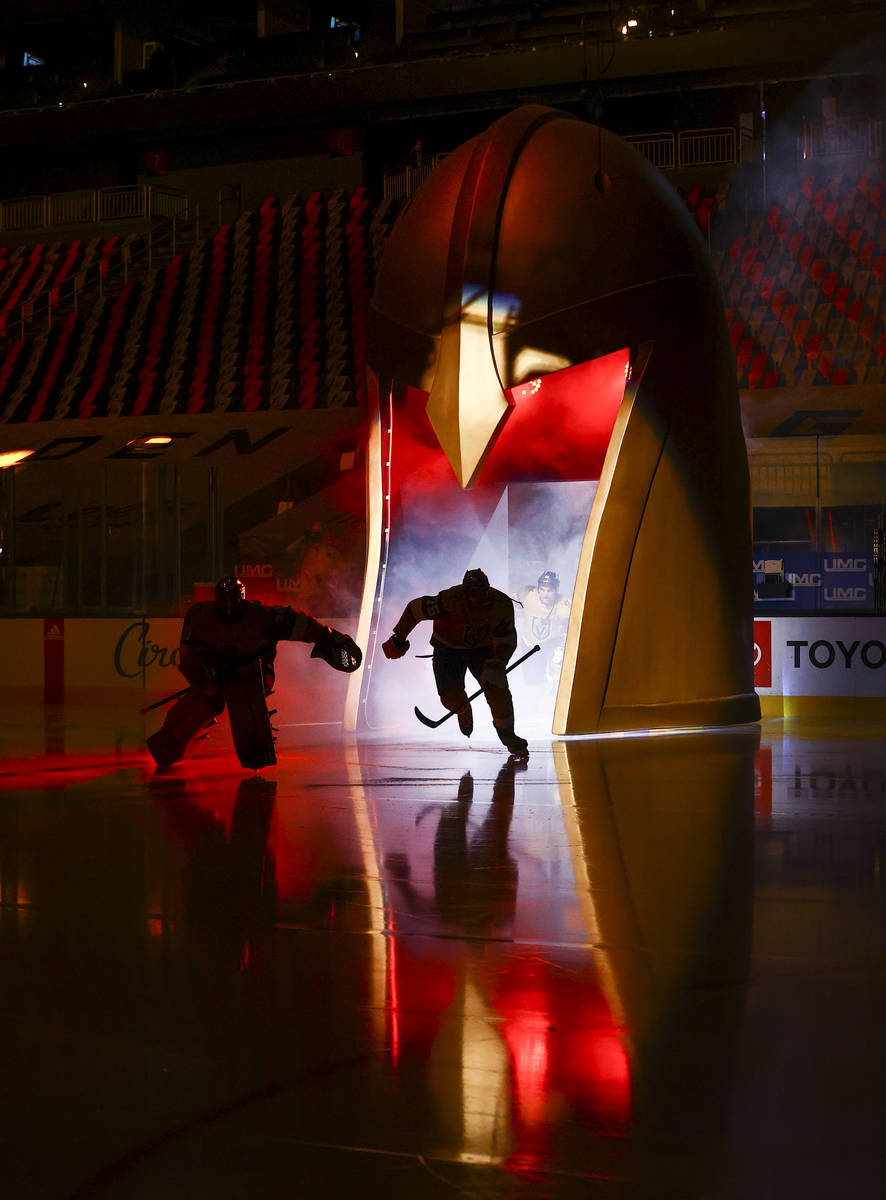 Golden Knights players skate onto the ice before taking on the Anaheim Ducks in an NHL hockey g ...