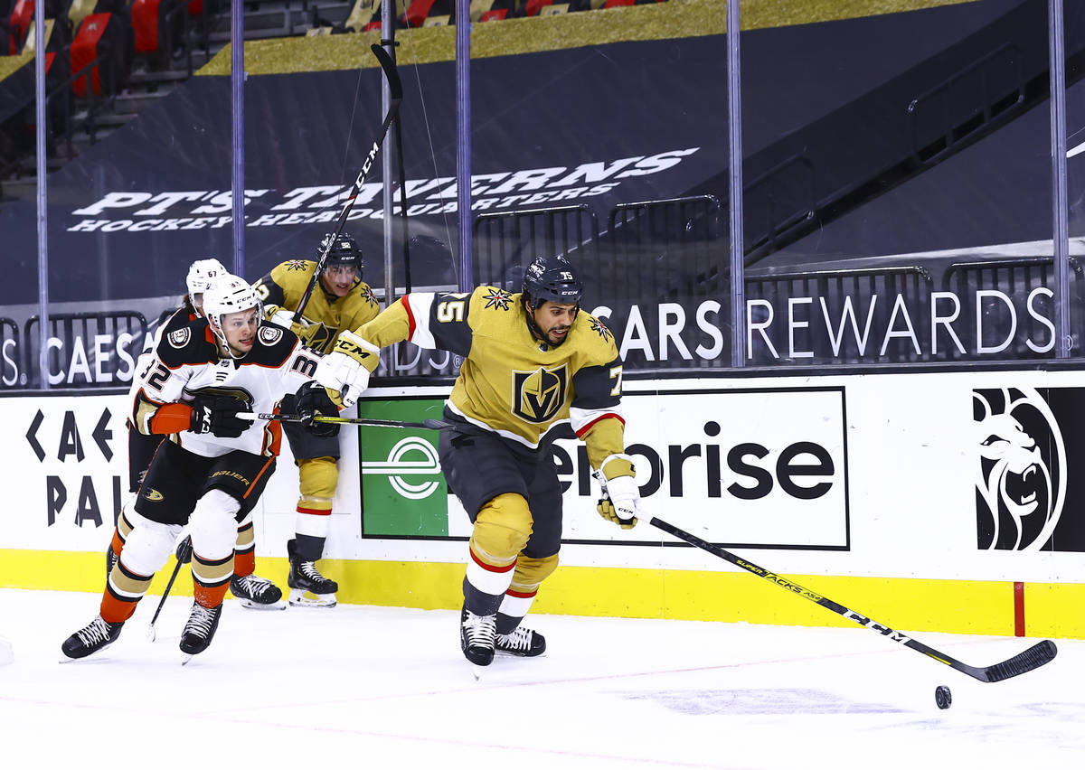 Golden Knights right wing Ryan Reaves (75) chases after the puck in front of Anaheim Ducks defe ...