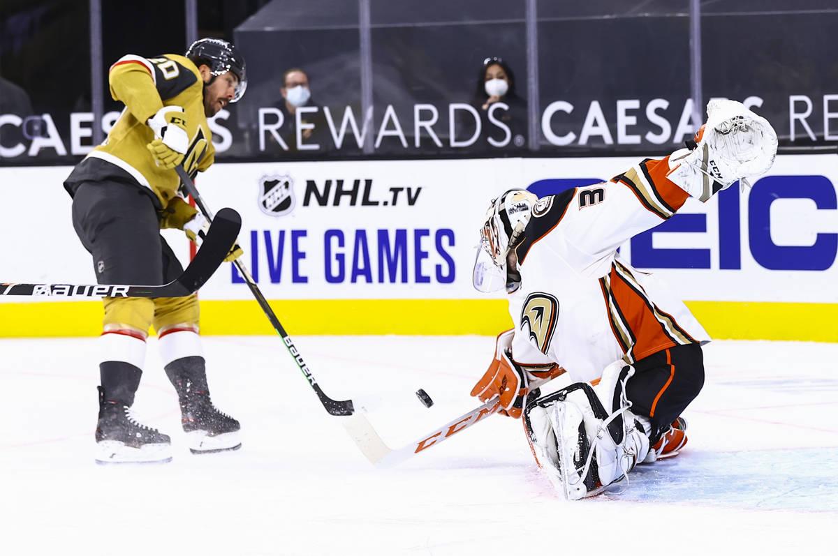 Anaheim Ducks goaltender John Gibson (36) blocks a shot by Golden Knights center Chandler Steph ...