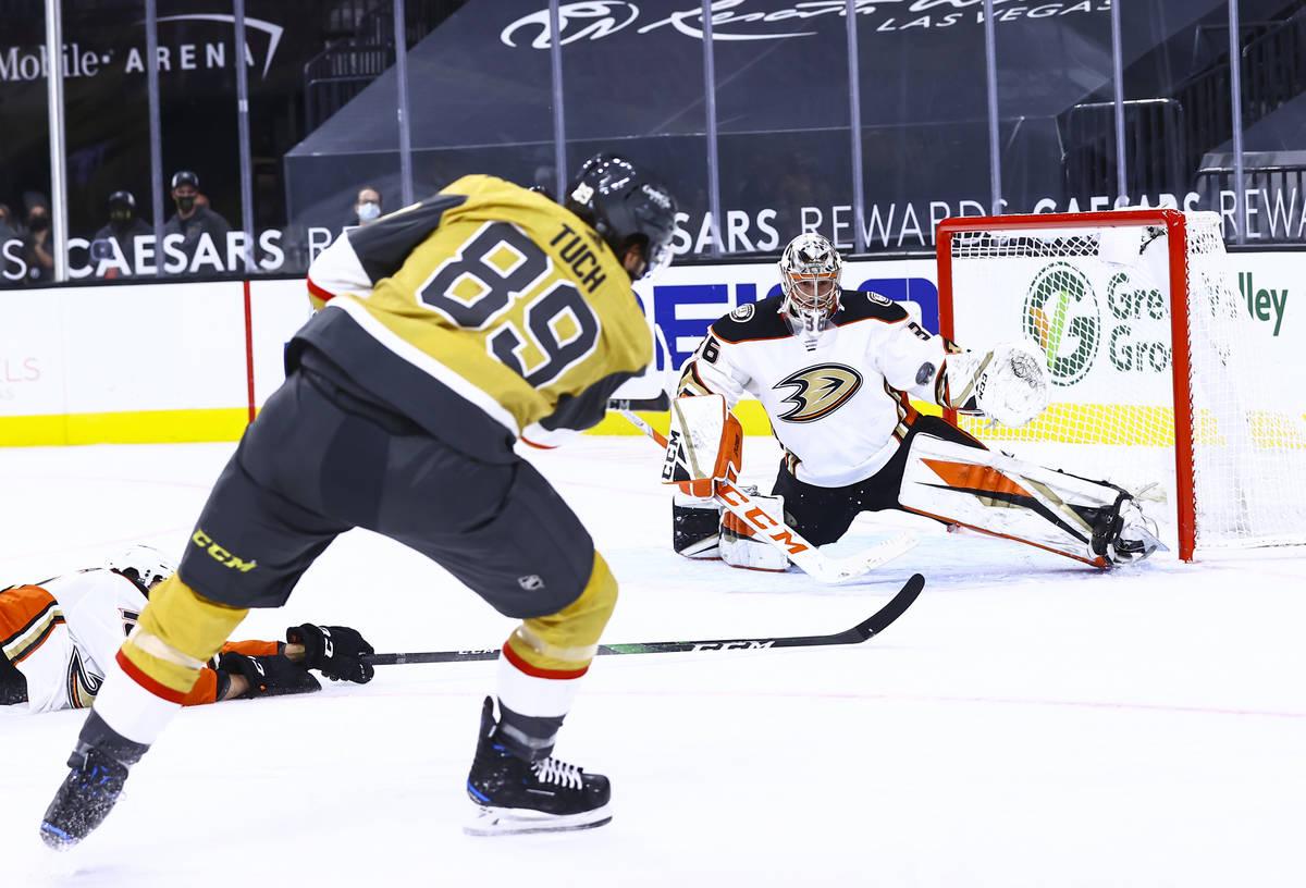 Anaheim Ducks goaltender John Gibson (36) blocks a shot from Golden Knights right wing Alex Tuc ...