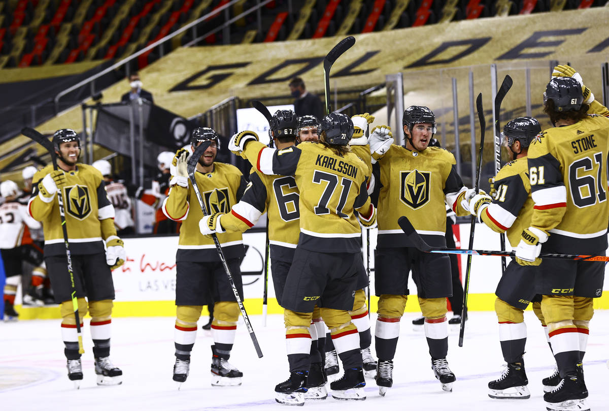 The Golden Knights celebrate after their overtime win against the Anaheim Ducks in an NHL hocke ...
