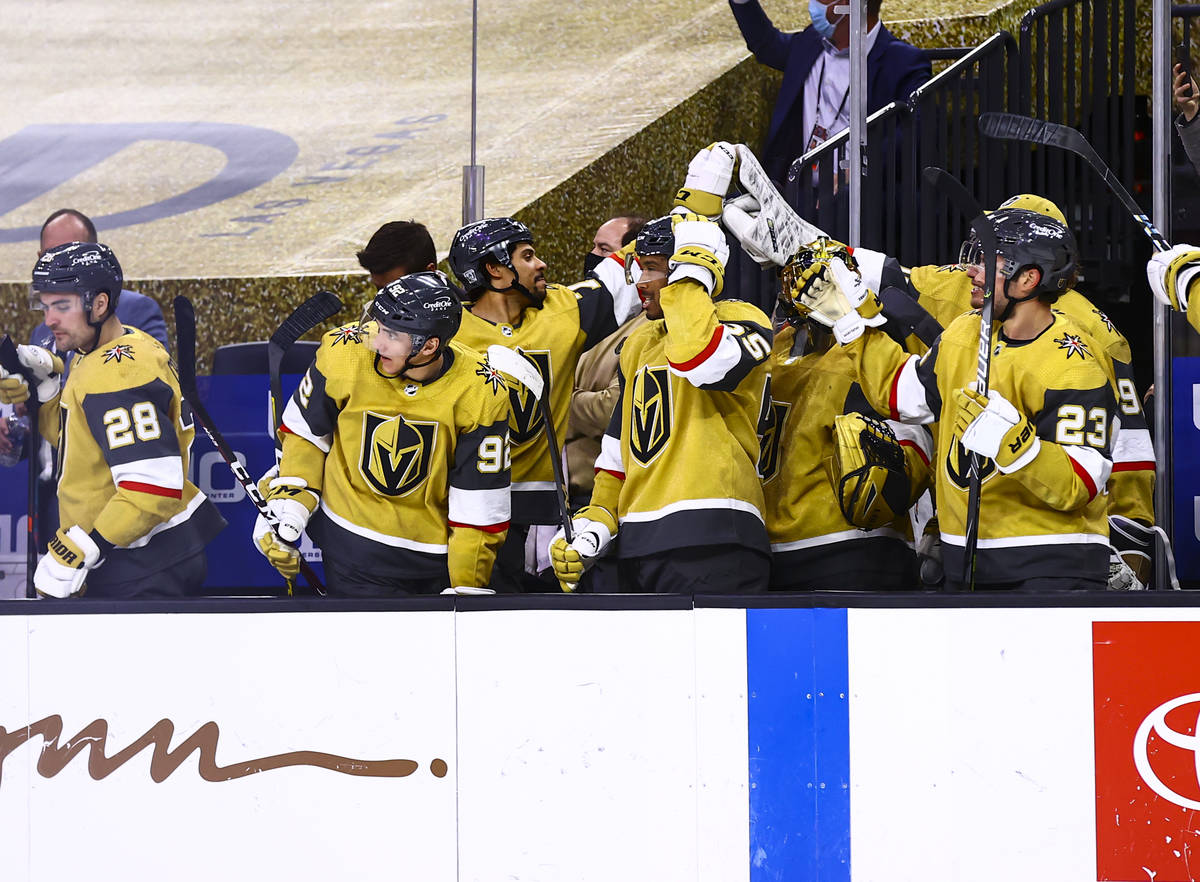 The Golden Knights celebrate a goal by center William Karlsson, not pictured, during the third ...