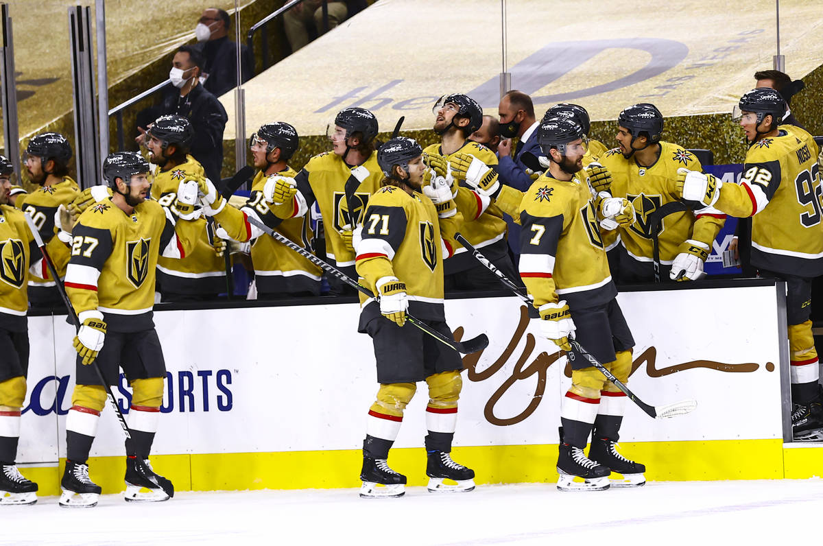 The Golden Knights celebrate a goal by center William Karlsson (71) during the third period of ...